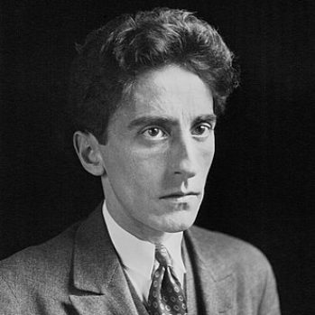 Black and white portrait photograph of Jean Cocteau c.1923