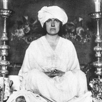 Mabel Dodge Luhan wearing turban in yoga pose, circa 1915