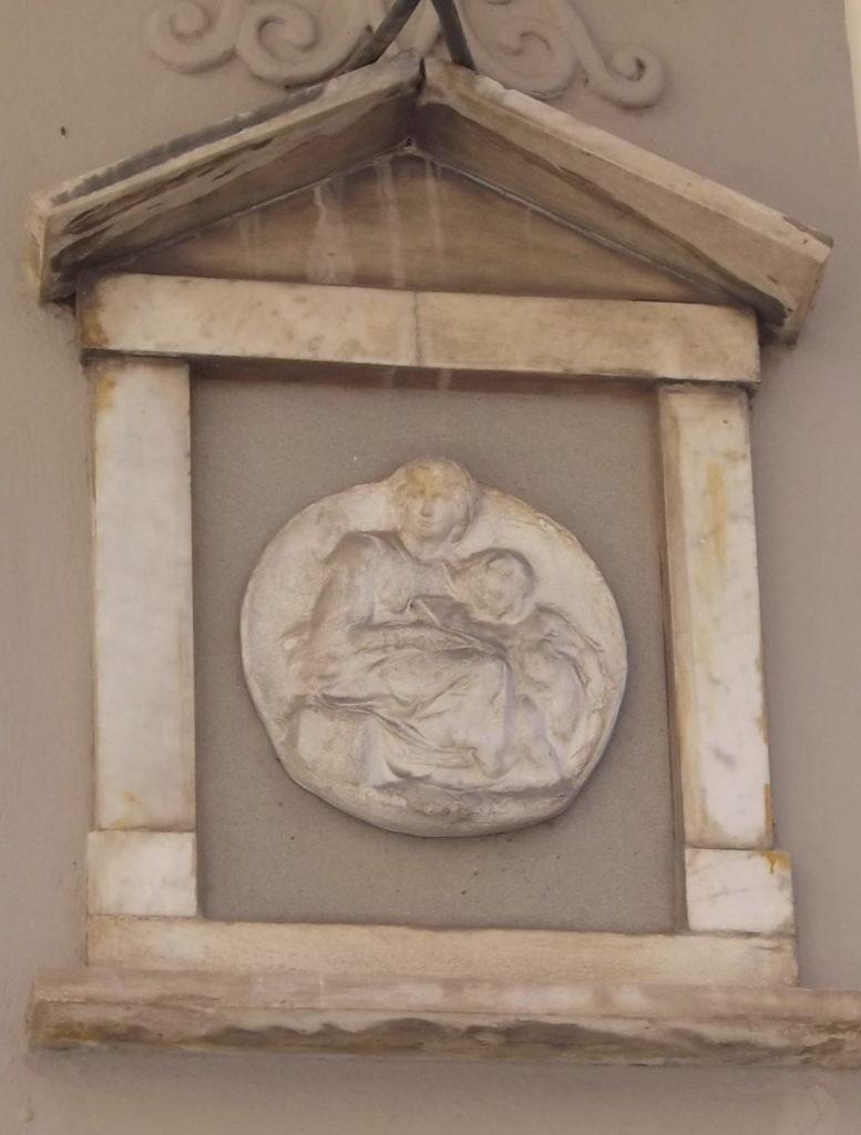 circular bas relief Madonna