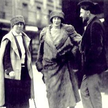 Jane Heap, Mina Loy, and Ezra Pound standing on sidewalk