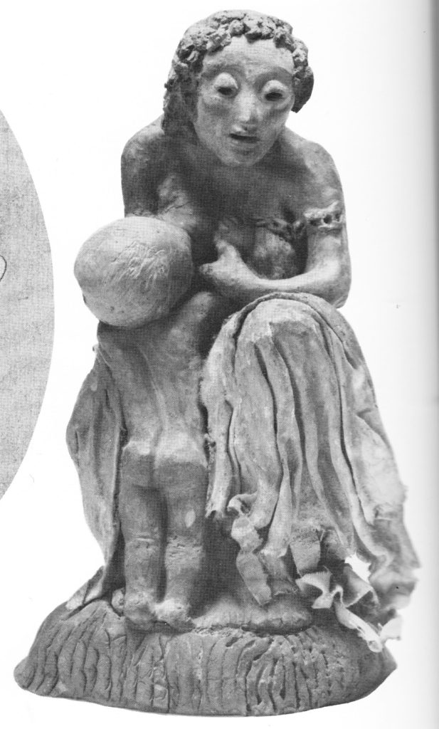 sculpture of a seated mother nursing a kneeling child