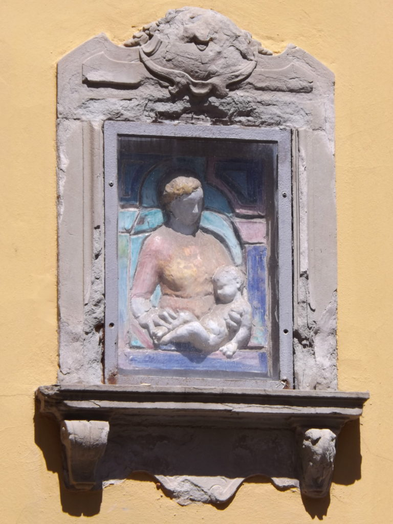bas relief of madonna and child