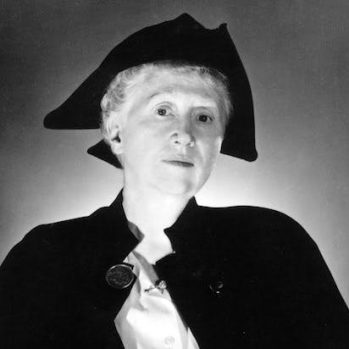 Moore in her tricorn hat and cape