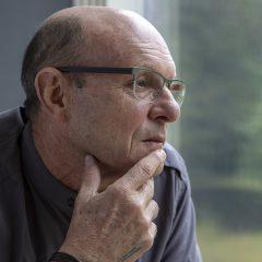 Conover in a pensive profile view