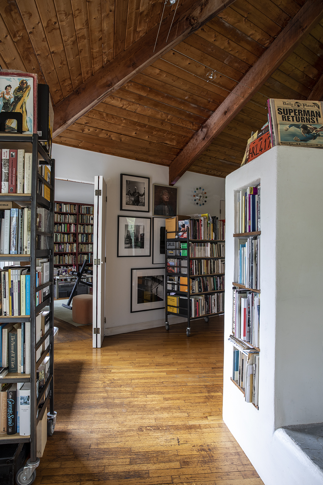 interior of Conover's home, with built-in book shelves and framed art.