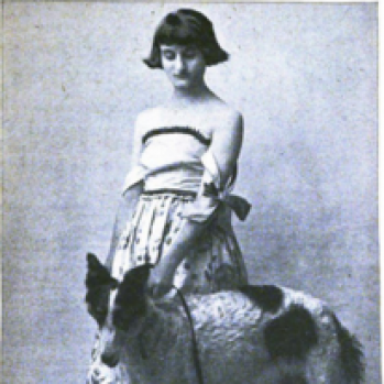 black and white portrait photograph of Clara Tice with dog
