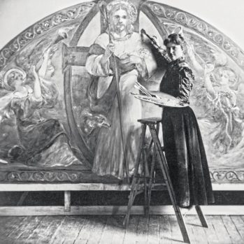 Katherine S. Dreier standing on stool with palette in from of mural at Saint Paul's School in New York